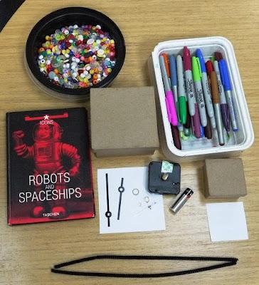 kartondan-robot-seklinde-calisan-saat-yapimi-1