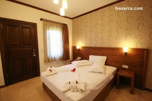 datca-orcey-hotel-konak-yatak-odalari