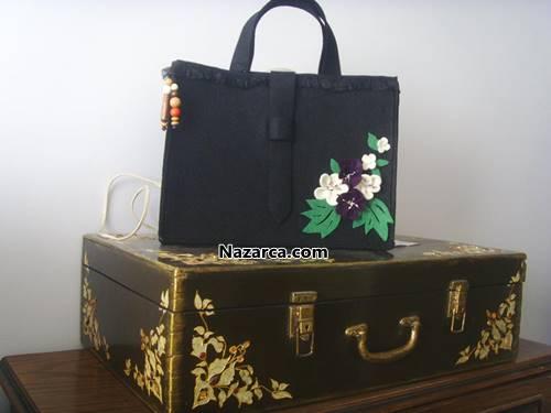 Siyah ve şık keçe bayan el çantası