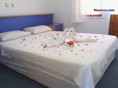 Fethiye-Yeni-İstanbul-Apart-Otel-Apart-Otel-oda-yatak