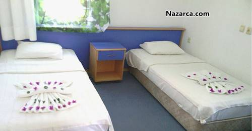 Fethiye-Yeni-İstanbul-Apart-Otel-tekli-yataklar