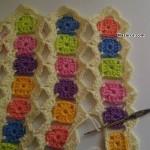 kucuk-renkli-motiflerden-tig-isi-bebek-battaniyesi-7