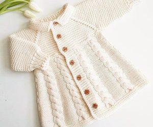 sac-orgulu-bebek-manto-beyaz